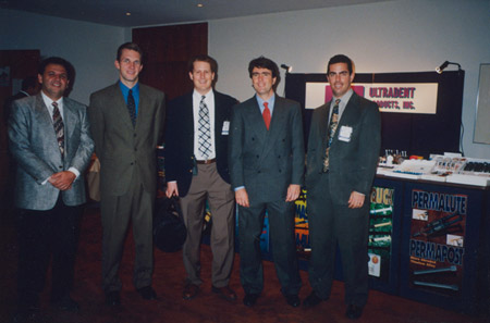 Dirk Jeffs (second from left) works a trade show early in his career at Ultradent.